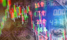 Double exposure of stock market in tablet with money and chart.